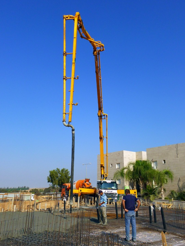 picture of a concrete line pump attached to a boom truck in Roseville, California